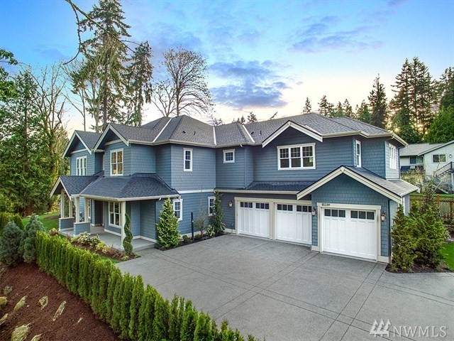 Luxurious and private living in the heart of downtown Bellevue, just steps away from everything! Grand entrance greets you with soaring ceilings, circular staircase and gorgeous hardwoods. Designed to entertain, you'll love the great room floorplan and outdoor living area complete with stone fireplace. Chef's kitchen features Wolf/SubZero appliances, dual ovens, and huge center island great for baking cookies & doing homework . Coveted Bellevue Schools - walk to Clyde Hill Elem & Chinook Middle