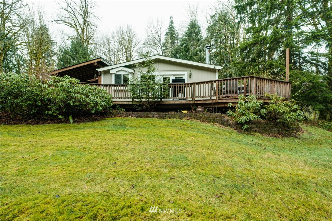 Curving gravel driveway leads you to this tucked away diamond in the rough on beautiful 3 Acre lot in North Bend. Quick & easy access to I-90, Snoqualmie Pass, and North Fork Rec area. This 3BR, 2BA home features spacious kitchen/dining area/family room. Cozy wood-burning stove, & new stovetop in kitchen with eating bar. 2 BR's share full BA & Master BR boasts private 2nd BA w/spacious soaking tub. This property is a nature lover's paradise! Creek-bed running through property fills a few weeks out of the yr when snow melts! Private hunting permitted on site. 7 outbuildings scattered about the property for easy storage, both mounted TV's & mower to convey w/sale. Move in today, or tear down & build your dream home on this one of a kind lot!