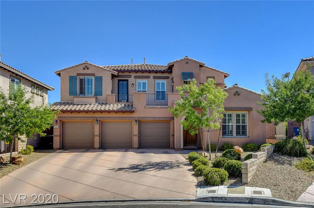 Stunning home in Summerlin West... This home features 4 bedroom, 4 bath, 3 car garage with strip/mountain views. Kitchen w/Granite counters tops, custom cabinets, built-in entertainment center, arch passages, balconies in front & back, plantation shutters throughout, downstairs master w/ soaking tub, custom shower, his/hers sinks, gorgeous backyard.