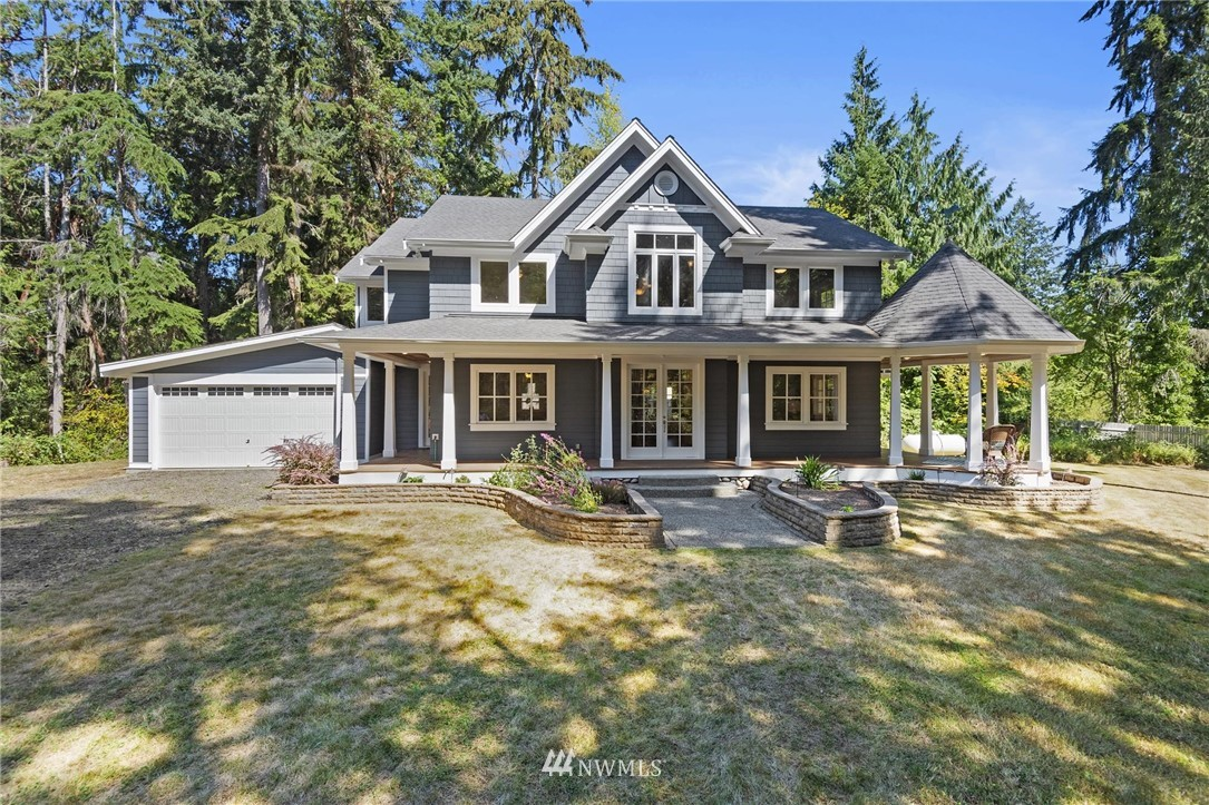 "Seabeck serenity and this magical custom home will immediately have you captivated! TWO parcels, totaling 2.16 acres w/ an extra building lot provide endless possibilities.  Step through the french doors to soaring timber framed ceilings open to the second story.  Kitchen is open to the living areas featuring double ovens & professional range.  A professionally installed HUGE organic garden that will rival any you have seen, shop w pellet stove, 12 x 16 ""barn"" w/ power & loft, fruit trees & more"