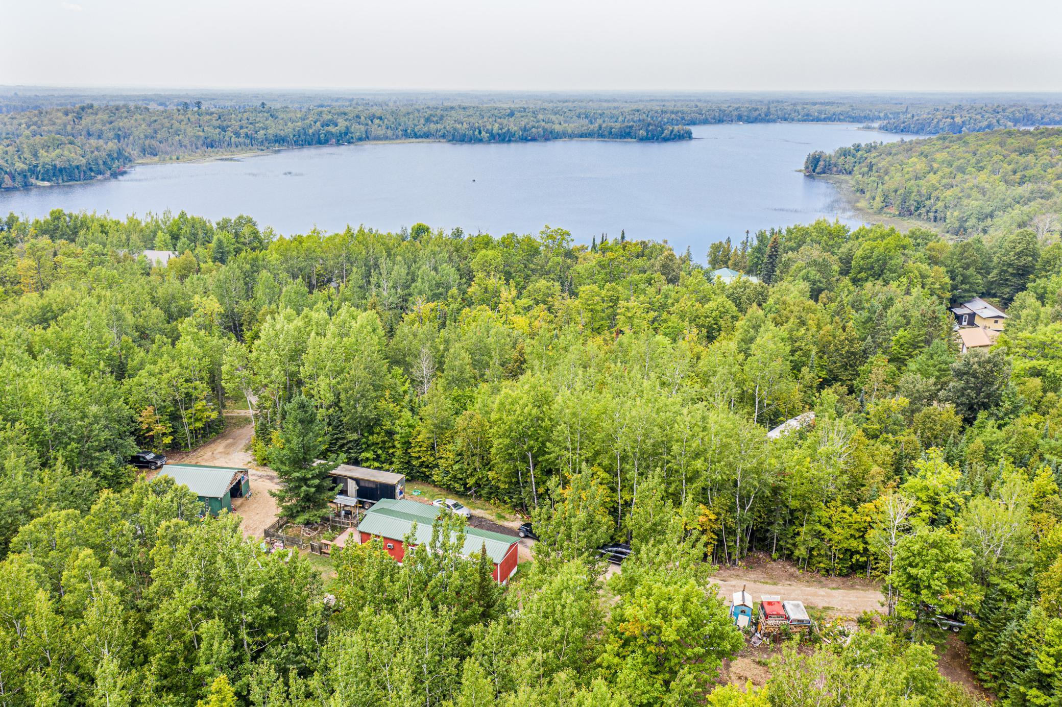 Almost 7 acres just steps from North Star Lake! Great building opportunity with a compliant septic, newer well, and electric already in. Property adjoins federal land to the north. Property has a pole barn, a loop driveway, and an older mobile home. Use as is or build your dream house or cabin!