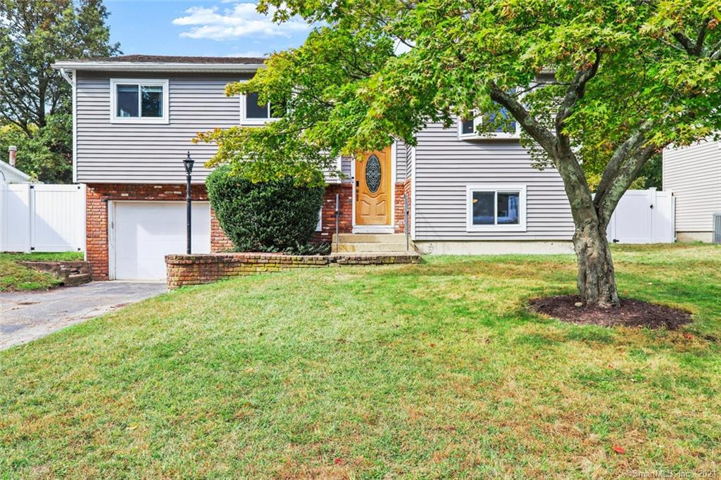 Welcome to your West Norwalk Oasis.  Convivence, Privacy and Love are adjectives used to describe your new home!  Beautifully appointed kitchen that opens up into a stunning living space.  Enjoy the tranquility in the back yard that features a beautiful deck and 15 x 30 heated pool.  The spacious lower level allows for an additional bedroom, full bath, living space, large mudroom and laundry room.  The oversized 1 car garage is key on those cold, rainy, snowy and warm days.  Conveniently located to I-95,  Merritt Parkway(15), SoNo Collection Mall, Train Stations, Highly Rated Restaurants and All of the Amenities Norwalk has to offer.  See attachment for updates/upgrades.