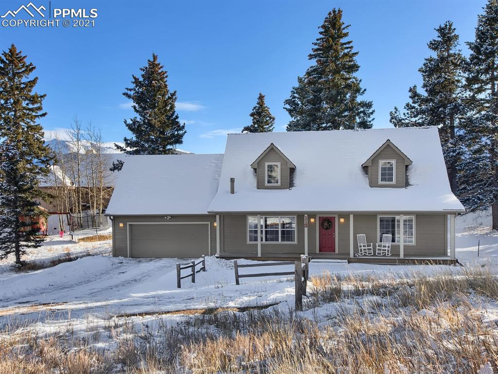 Immaculate home in HIGHLY desirable sought after neighborhood! Quick & easy access to Hwy 24, minutes to Woodland Park and about a 35 minute commute to Colorado Springs. The master and upper bathroom are a MUST SEE! Just wow! They are updated and stunning! Main level living with vaulted ceilings in living area and master bedroom. TONS of natural light. Relax outside on the patio and enjoy the mountain views. Top bedrooms boast views of Pikes Peak.  His & her closets. New furnace isn't even a month old! DIVIDE WATER!