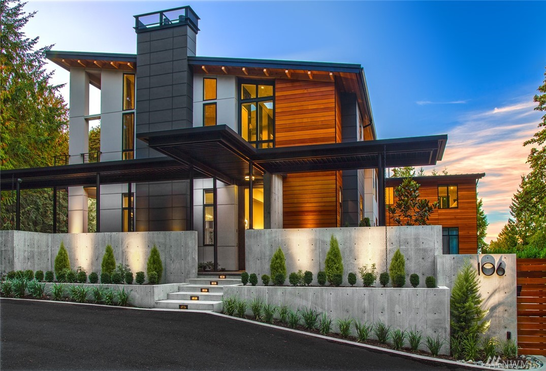 Modern Luxury in the heart of Bellevue. This newly built architecturally stunning home has been crafted with unmatched details: concrete, steel beams & gleaming Brazilian Olive hardwoods. This modern showcase is sited on a gated & private 35,000sf lot. No expense was spared in building this home featuring: 5 en-suite bedrooms, walls of glass, covered outdoor living area a & a beautifully crafted floating wood & steel staircase. Generous auto court & garages for six cars. Harmony. Dramatic. Rare.