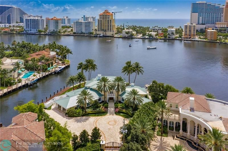 No expense was spared in this stunning British West Indies home! This point lot has mega yacht dockage w/ 3 phase power & breathtaking Intracoastal views in a no wake zone. Gated property w/ all the bells and whistles such as high-end finishes throughout, gourmet kitchen w/ commercial exhaust system & top-of-the-line appliances including 12 burner gas stove, 2 master suites, 2 offices, walnut wood & marble floors, elevator, 20,000lb boat lift, full house generator, Crestron smart home system & security system. Resort style backyard w/ salt water pool, outdoor kitchen, irrigated Astro Turf & cabana bath. Perfect for entertaining all year w/ amazing views & a constant breeze. Located in thesecurity patrolled Seven Isles neighborhood close to Las Olas shops, fine dining, the beach & airport.