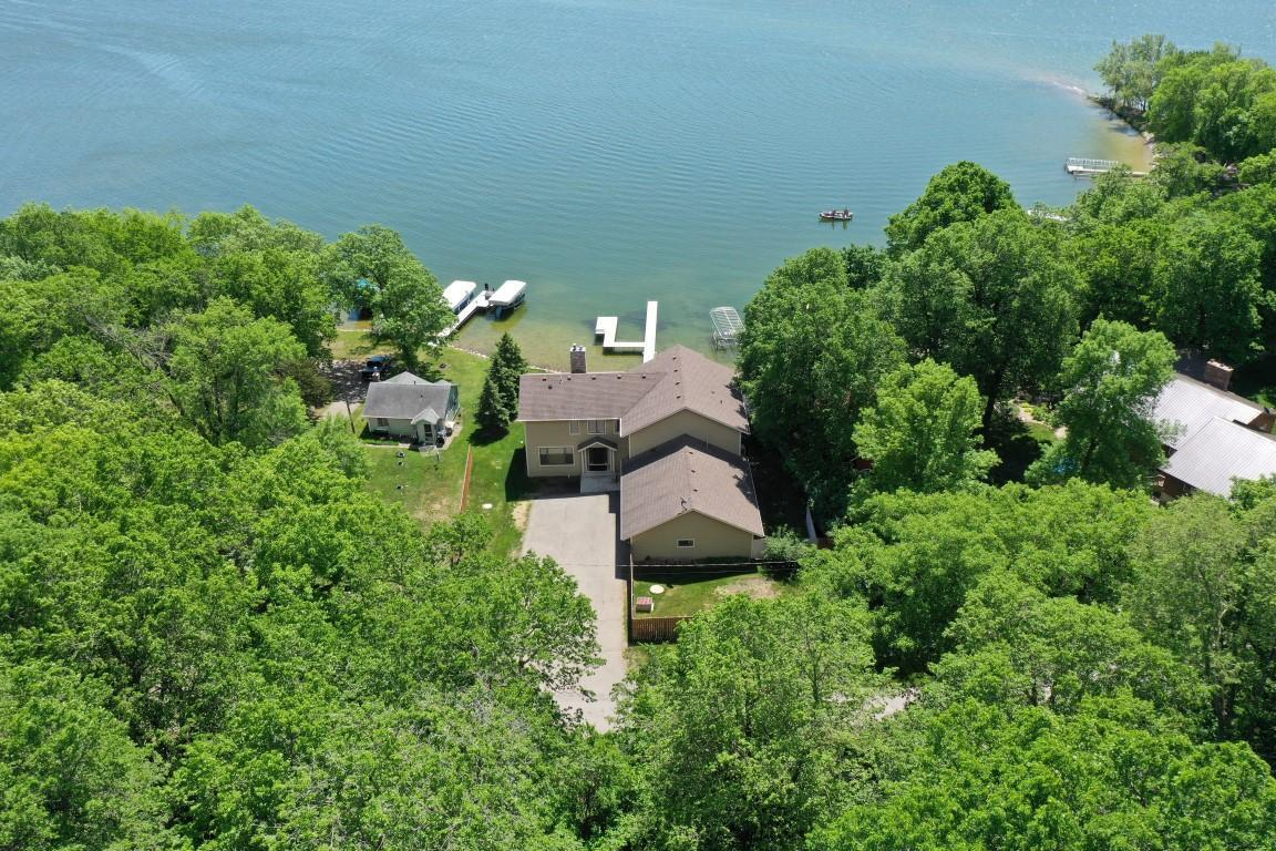 Amazing 3 Bedroom and 3 Bath beautiful Lake Home with Million Dollar Views and Level Lakeshore and 3500 Finished Sq. Ft. makes this the Gem of the Season. 3 Gorgeous Fireplaces -2 gas and 1 Wood Burning -Makes it super Cozy!  Top Quality throughout the Home. Wonderful Patio Doors or Windows from every Room to make the most of the gorgeous views. Home is at the end of the Road so not much traffic. The 1000 Sq. Ft. No Maintenance Deck with Grill and Fireplace and Hot Tub has got you covered for all Your Entertaining Needs.  This Beautiful Home is spacious and nice quality. 3 Car Garage is convenient for Water Toys and Vehicles. Please see Supplement for Additional Information.