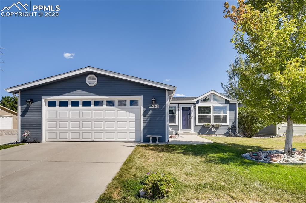 Immaculate and beautiful modular home in Antelope Ridge.  Open, bright living area with vaulted ceilings throughout, lovely large eat in kitchen with walk out to a beautiful covered patio and landscaped and fenced backyard - no neighbors in back - watch the Pronghorns from your patio.  Many architectural touches; paneled doors, rounded corners, crown moulding, floor to ceiling wall of windows in the living area and more.  2 bedrooms, 2 baths with oversized walk in showers, as well as an office/den off the living area.