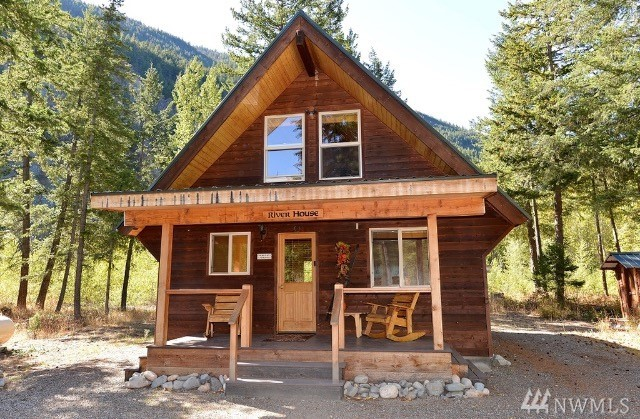 A thriving nightly rental Cabin, on an extra large lot with 202' of riverfront. Pine-wrapped walls with big view windows to gaze at mountains & river. Super floor plan feels roomy yet not too big. 2 BR, 1 BA, W/D, great front porch & large back deck with just-right combination of firs for shade & excellent natural light. Turnkey with all furnishings incl. Successful rental allows you to off-set or eliminate costs.