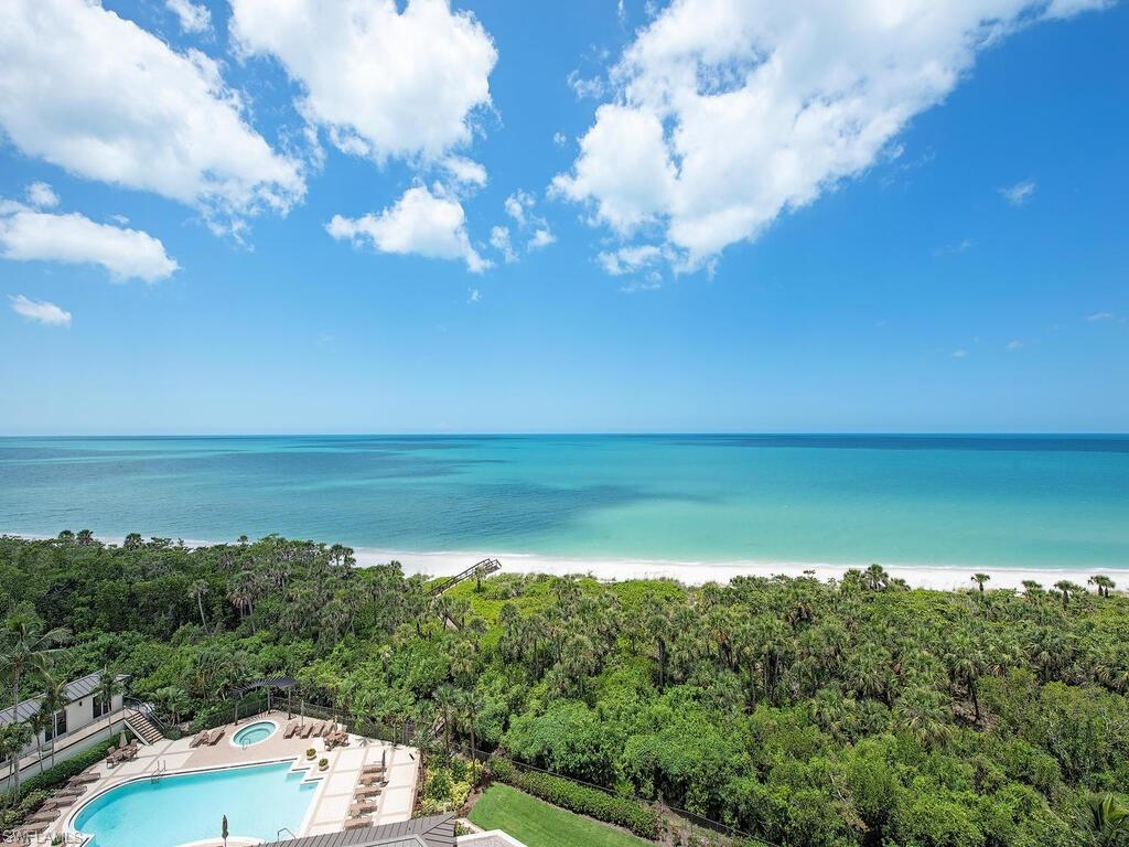 """C3418 - Bright, Sunny, corner Bay Colony BEACHFRONT Contessa JEWEL w/cabana available separately! Perfect easy-beachy living """"smack-dab"""" on the sand, w/stunning, panoramic, floor-to-ceiling window walls wrapping the entire Gulf-front living areas. Contessa, renowned for private, unobstructed Gulf-front views, will soon be the envy of all, due to its $3M+ Lobby & Amenity floor Re-Mastering now underway with a November 2021 completion. Chiseled-edge flooring, foyer & kitchen custom cabinetry, granite counters, S/S appliances, three generous bedrooms, each w/en-suite bath, a den currently being used for dining + guest powder room accommodates all with ease. Contessa offers all the amenities one anticipates in a tower of this stature, including attended 24/7 front desk + a rare on-site Har-Tru tennis court. Don't forget the exceptional World Class included amenities via your Bay Colony & Pelican Bay Membership privileges: 2½ miles of sugar white sand beach, 3 Gulf-Front Beach Clubs w/casual open air or more formal indoor dining, attended beach services, 3 tennis centers, state-of-the-art fitness, life-long learning center, canoeing, kayaking, miles of walking, biking, & nature paths."""