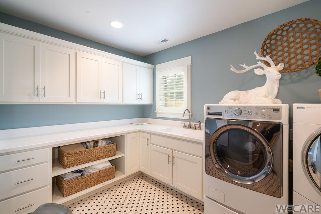 Laundry with utility sink in lower level