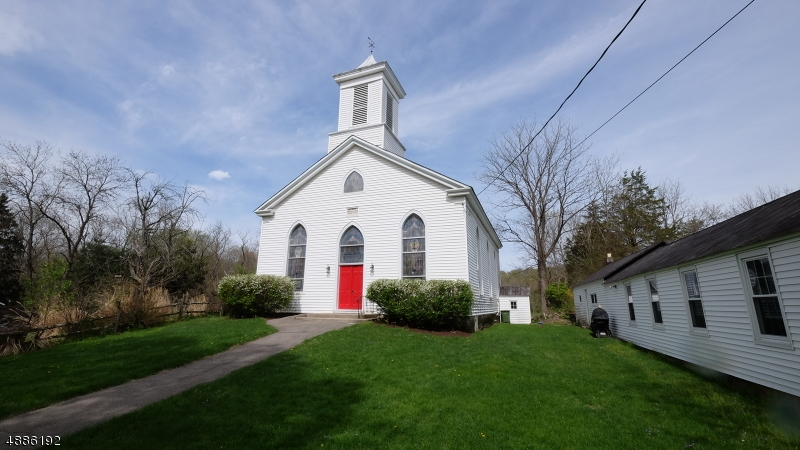 Lovely 1850's church in small country town. Sanctuary and detached Fellowship Hall available for worship but this property is zoned for other uses. Unique opportunity to own a piece of history.  May be possible to convert to residential home.