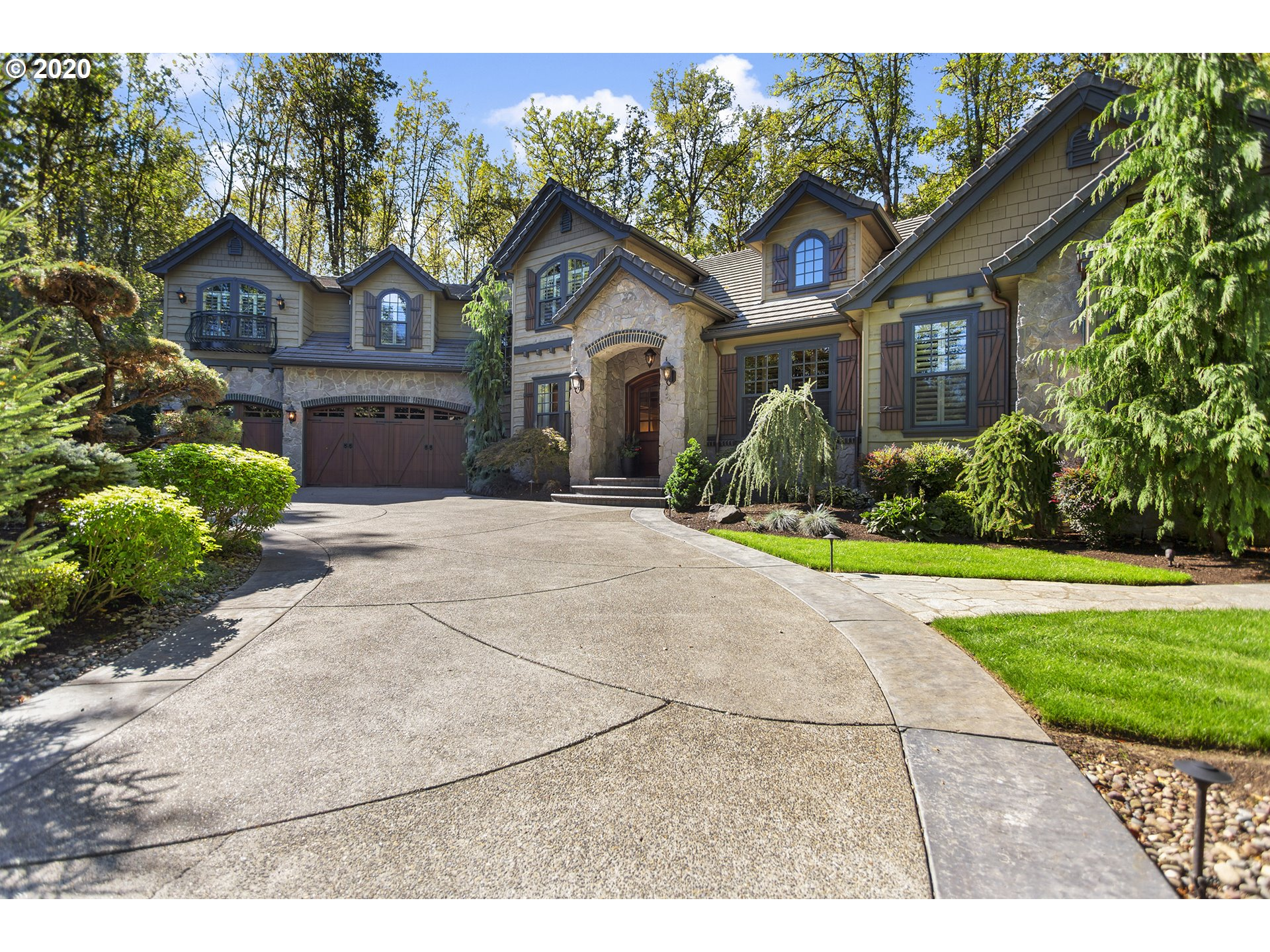 Come home to a private, French Country sanctuary on .66 acres with gated entry in Lake Oswego's Glenmorrie neighborhood. Timeless finishes, Old World touches & deluxe features combine to create a classically beautiful home with a luxurious & livable floor plan. Master on the main, show stopping kitchen/great room, indoor/outdoor living year-round with covered patio & uncovered outdoor fireplace. Surrounded by green space steps from top-rated Hallinan Elementary & close to downtown.