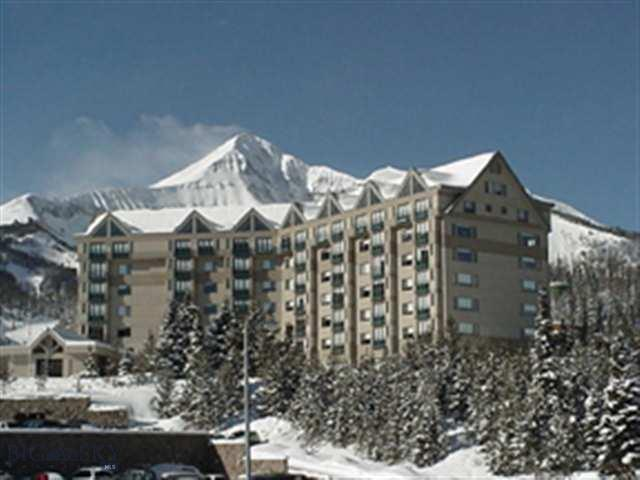Spacious corner unit with fabulous views of both the Spanish Peaks and Lone Mountain. Upgraded furniture package and great rental history. Enjoy the convenience afforded to all Shoshone owners: slope side access, on site laundry, restaurant, bar, spa, and fitness facility.  Walking distance to the Exchange and the heart of the Mountain Village.