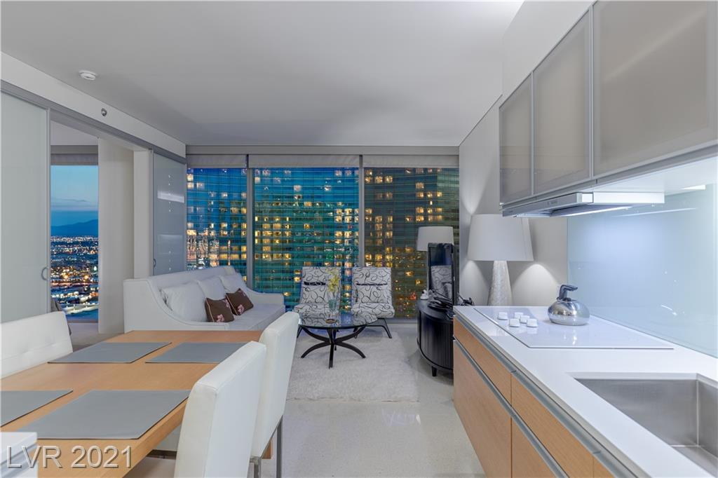 Introducing Veer Towers 2902 - An immaculate, high floor, one bedroom condo with views of las vegas and city center including the Aria and The Cosmopolitan. FEATURES INCLUDE: An open layout, stainless appliances, center kitchen island with seating for four, floor-to-ceiling windows with blinds, all in pristine condition. Located in City Center, one of the most expensive developments in the US, Veer Towers has complete amenities such as a 24 Hour Valet, Concierge, Pool and Spa with City View, Gym and Lounge with Bellagio Fountain and Strip Views, Billiards Room, Business Center, and is Surrounded by the Best Dining, Shopping, and Entertainment in the World. Convenient walkability to Las Vegas Blvd Strip and walking distance to T-Mobile Arena where you can watch your favorite Concerts, UFC Events, NHL events, and more. Less than 10 minutes to the Airport and central access to all of Las Vegas.