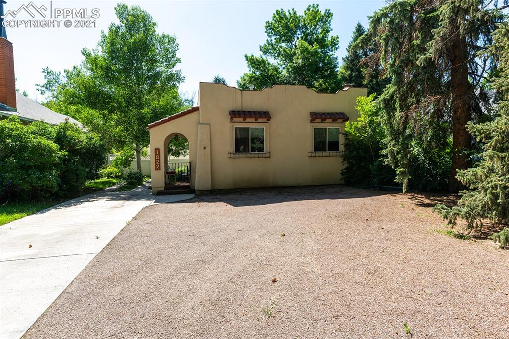 Here is a true gem located in the historic old North end within walking distance to Patty Jewett golf course which is the third oldest public golf course west of the Mississippi!  The lot has mature trees and has a fully fenced private backyard for entertaining!   You will love this charming 1940 rancher with a covered front porch, original wood floors and Italian stucco walls & ceiling in the living room along with a cozy fireplace!  This home has 3 bedrooms and 2 full baths along with a country-style eat-in kitchen.  The basement has an additional room which could be used as a den/bedroom making it a possible 4 bedroom home.  This home also has air conditioning and a humidifier along with newer double pane vinyl windows.  The appliances all stay along with the washer/dryer.  The refrigerator is only two years old.  The backyard has a nice 10 X 12 shed that is included and a detached 20 X 12 garage.  There is a large garden area as well that has a concrete base that could be used for a basketball court or additional patio area. Don't miss out on this rare find in this historical neighborhood!