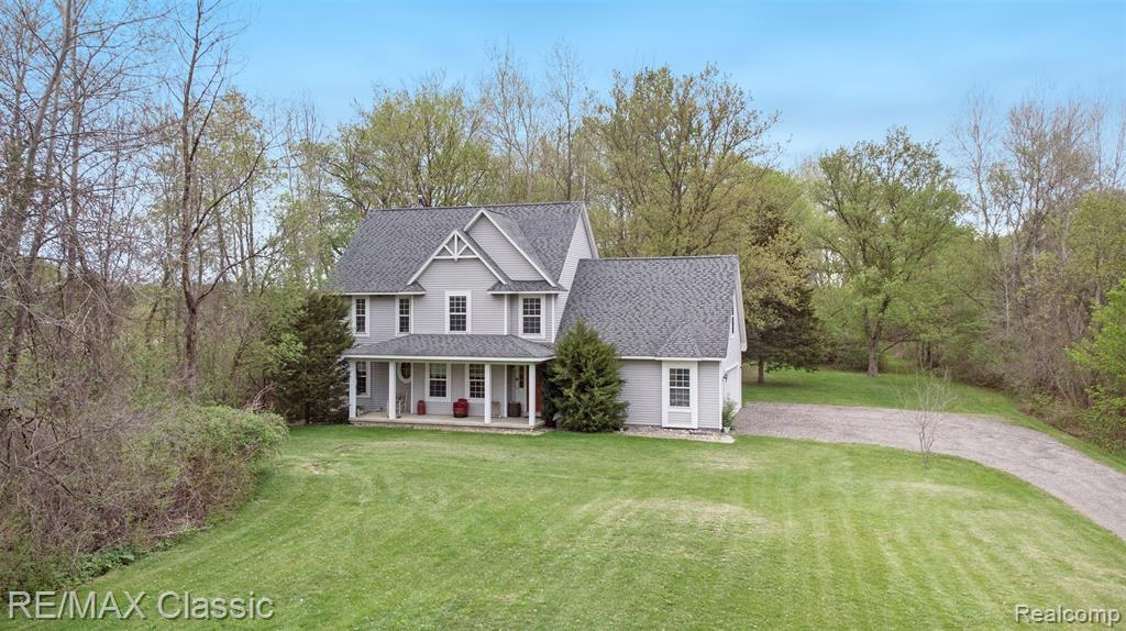 BEAUTIFUL PRIVATE WOODED 2.94 Acres in Commerce. Lots of room to roam inside & out of this 5 bedroom, 3 bath, 2,000 sq.ft. Colonial. 2 car attached garage, plus detached 20x20 hip roof barn with 20x10 upper loft & new garage door, plus 20x20 Carport. Minutes to Proud Lake State Rec area & camping. The main floor has a nice size living room, kitchen with doorwall to the back yard, full bathroom with dual entry & big laundry room. The wall in the 1st-floor bedroom could be removed to make it larger again (14x10), it was split to have separation in the room. 2nd floor is huge with 4 bedrooms and 2 full baths, 2 of the bedrooms do not have closets, 15x6 sitting area, large hall closet & smaller linen closet. Great basement for entertaining with enough seating for 6 at the bar & plenty of storage space. Newer furnace & HWH. Original owner. Good solid home but may need some updating. The property has a path leading to the back, you can watch the horses play at the neighboring farm.