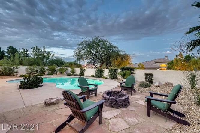 ** STUNNING LUXURY HOME NESTLED IN THE BACK OF A CUL-DE-SAC. **UNIQUE PROPERTY WITH EXTRA GUEST PARKING AND PLENTY OF SPACE TO ENTERTAIN. **JUST UNDER A 1/4 ACRE IN ONE OF THE MOST HIGHLY COVETED NEIGHBORHOODS IN LAS VEGAS.  **A QUIET AND CONCEALED BACKYARD OASIS WITH NEWLY TILED SALTWATER POOL, FIREPIT, BARBECUE AREA, ALONG WITH COVERED PATIO WITH TV. **ENTIRE HOME HAS 13' CEILINGS! **WOOD PLANK-PORCELIN TILE LINE ALL COMMON AREAS. **COMPLETELY REMODELED KITCHEN WITH NEWER CABINETS AND THICK HIGH-END GRANITE WITH WATERFALL DESIGN. **HUGE SECONDARY ROOMS SEPARATE FROM THE PRIMARY BEDROOM. **NEW ELECTRICAL OUTLETS, 50 GALLON WATER HEATER, POOL EQUIPMENT, FAUCETS, HARDWARE. **STACKED STONE FIREPLACE **NEW APPLIANCES ALL AROUND **DON'T MISS OUT ON THIS ONE!