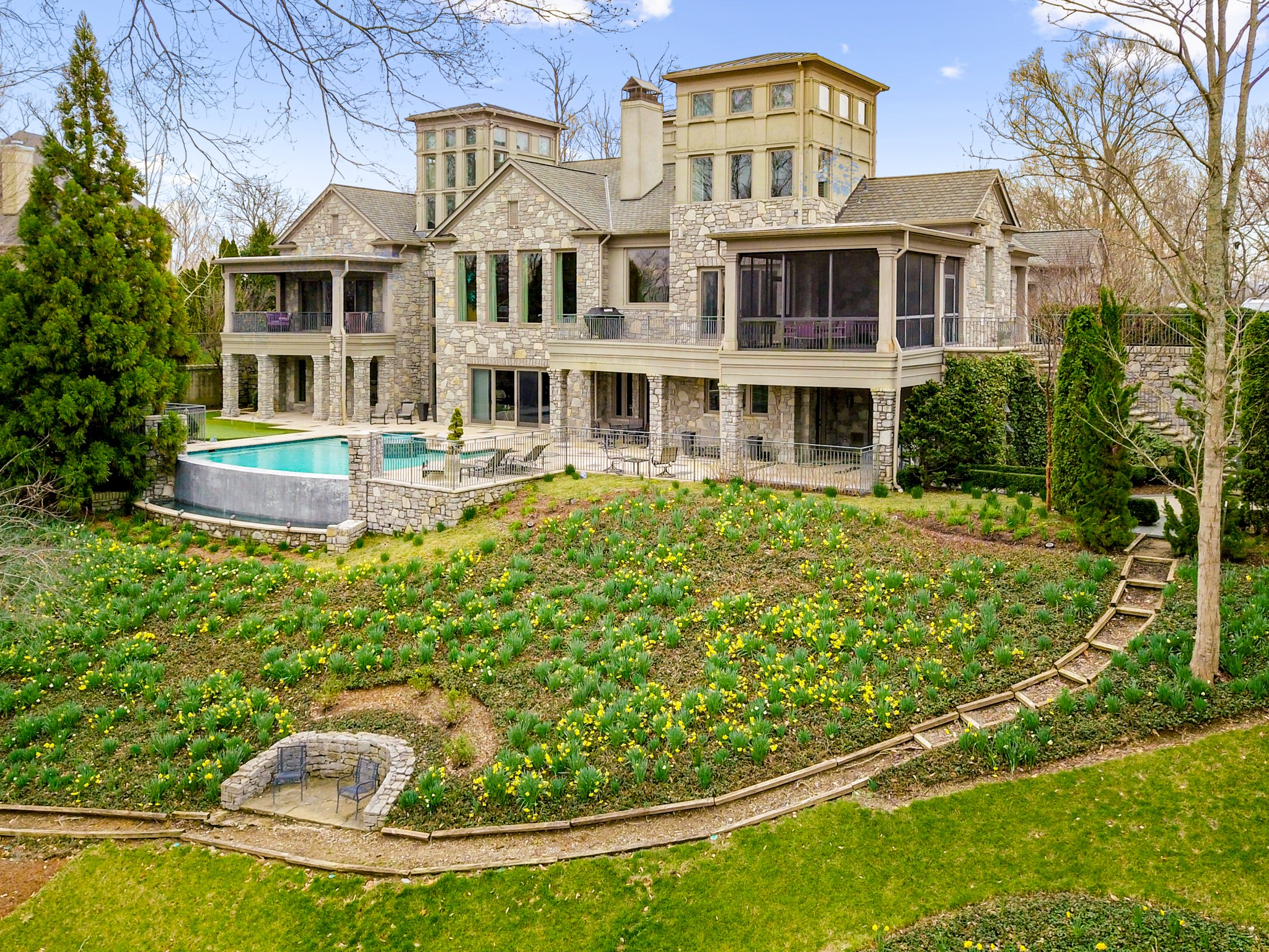 All expectations are exceeded in this exquisite custom residence designed by architect Scott Wilson * It's interior unfolds room after room of luxurious appointments * Custom features exist throughout including captivating fiber optic shelving in the dining room; Sapele wood cabinetry in the kitchen; and Venetian plaster wall & ceiling accents * Wonderful outdoor living areas include an infinity edge pool, screen porch, and balcony and terrace areas for entertaining and family enjoyment *