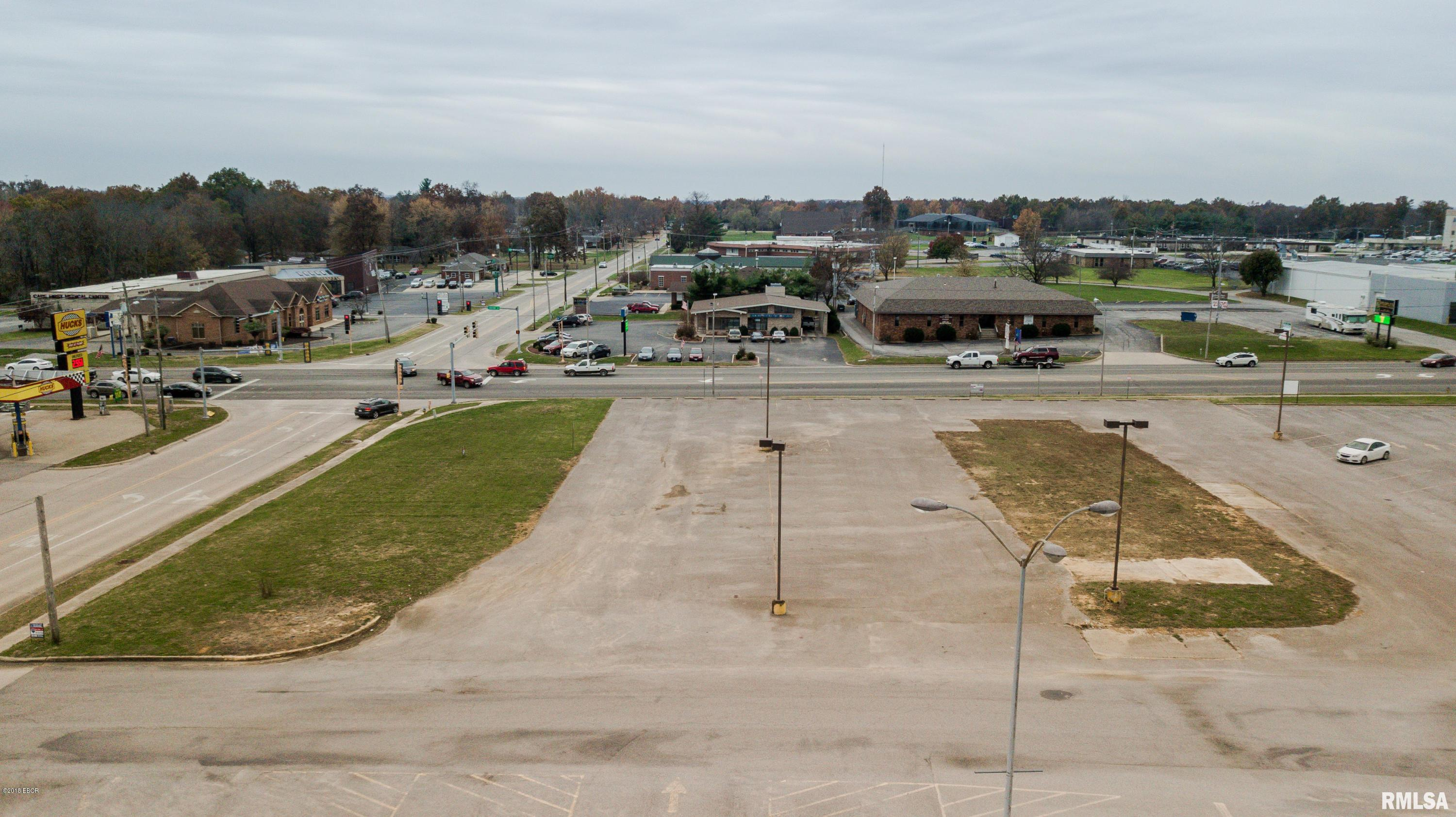 26,000 cars daily, four way intersection with traffic lights, 1.10 acres with two entrances, and zoned commercial. This location has it all. More property is available from the owners of the K-Mart building.Disclosure: Attached