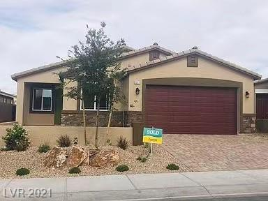 1-story 4-bedroom home in Henderson. Large kitchen island w/ stainless steel kitchen appliances, espresso cabinets, gorgeous granite counters in kitchen & baths. Tile throughout except for bedrooms. Paver stone driveways & walkways, BBQ gas stub, garage door opener, soft water loop.