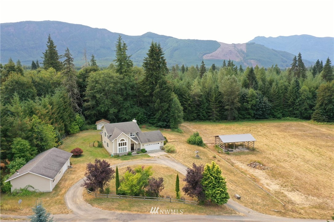 Spacious custom home on flat 2.5 acres. Garden shed, covered patio and 2 car detached garage w/den. The frame is up for barn or shop. This place is private, room to grow, bring the critters! Wonderful valley views. The den in this 2 car garage is very nice.