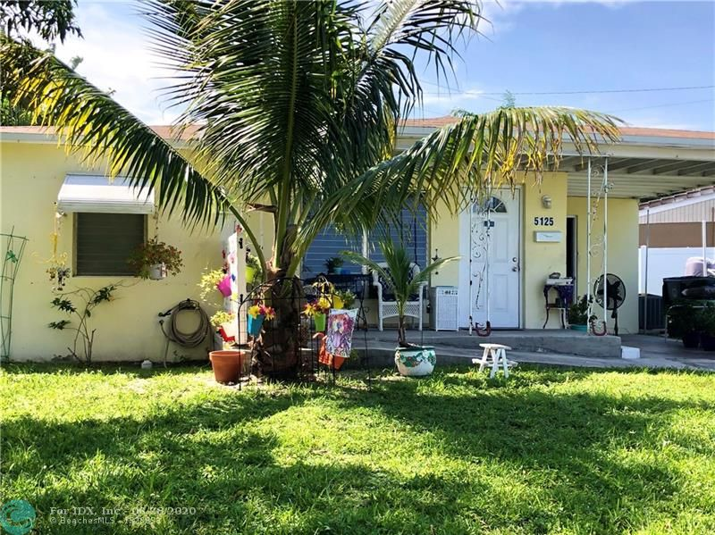 Located in the popular area of North Andrews Gardens, east of I-95 & only a short drive to the beach, shops and restaurants of Lauderdale by the Sea. This charming Florida bungalow features a new roof in 2018, new a/c unit & handler in 2014, upgrade of electrical to 200 amps, 1 year old dryer, gas hot water heater (looks newer) & a cozy front porch to relax on after a long work day. Huge sideyard gives plenty of room for a large entertainment area. Enjoy the easy to clean and maintain Terazzo flooring, solid wood kitchen cabinets, & gas stove for the cooking enthusiast. Living room, kitchen & an extra space for dining, office or a possible 3rd bedroom conversion. Tons of potential & retro charm!