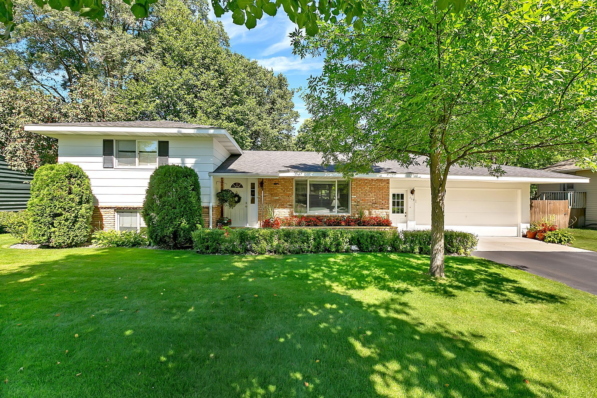 The owner's pride shows throughout this home and is move-in ready!  This one-owner home has great living spaces which include a spacious living room with gas fireplace and built-in shelves, cozy lower level family room, 4th level recreation room and an amazing screened porch which walks out to a wood patio!  Lots of storage space & crown molding throughout.  Cedar paneled family room, lower bedroom & rec room.  Beautifully manicured yard with in-ground sprinkler system, garden & mature trees.  Many updates including a newer furnace, Speed Queen washer & dryer, dishwasher, gas stove, garage door opener, attic insulation, carpet and exterior paint. Conveniently located near many city amenities.  A great place to call home!