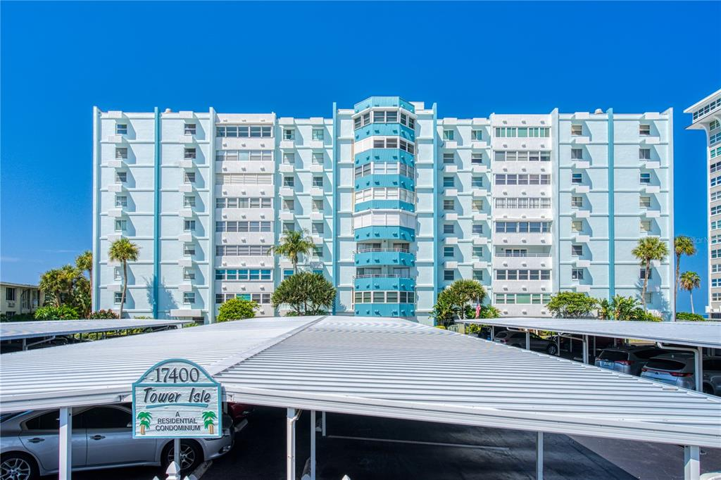 Incredible opportunity to own this fully remodeled, beautiful BEACH CONDO on the soft sands of North Redington Beach. Spacious floor plan which is closer to 1200 sq. ft. after incorporating the porch area into the living space. MODERN UPGRADES throughout including tile floors, NEW CUSTOM SHUTTERS just installed 9/23/21, full kitchen with dark stainless appliances, both bathrooms remodeled, new AC system, new water heater, new electric panel, CUSTOMIZED STORAGE CABINETS under wall of ENERGY EFFICIENT IMPACT WINDOWS, and brand new Miele washer and dryer - just to name a few! The LARGE MASTER bedroom offers an en suite bathroom and walk-in closet. And your guests will feel right at home in the second bedroom with direct access to the other full bathroom. The Tower Isle community is well-kept and offers residents & guests amenities such as SECURE ENTRY, elevators, BEACH-FRONT HEATED POOL and sun deck, grilling station, private BEACH ACCESS, outside shower/hose, additional storage on the same floor as your unit, internet & cable included in condo fee, and more. ASSIGNED, COVERED PARKING spot (#58) in front of building, along with ten visitor parking spaces. Located close to restaurants, pubs, convenience and grocery stores. Please be sure to check out the 3D INTERACTIVE VIRTUAL TOUR in the link above. Don't miss your change to own a piece of paradise!