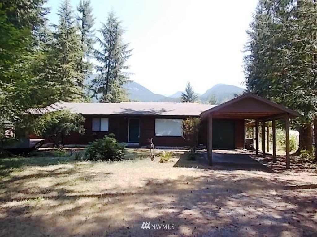 """End of Cul-de-sac 3 bedroom, 1 3/4 bath, 1188 Sq. Ft. Ranch style rambler, attached 1 car garage and 1 car canopy, room for RV and 2-3 more vehicles. has large deck with hot tub with overhead canopy, fenced on both sides and back line. Located in High Valley Park 8, Enjoy 9 hole par 3 golf course, summer time swimming, with Annual dues of $450 includes annual water use. Packwood with all services just 4 miles and approx. 24 miles to White Pass Ski Area. Experience great hiking, fishing, hunting, berry picking it's all right here. Sellers offering """"up to"""" $5,000.00 for new appliances with Full Price Offer."""