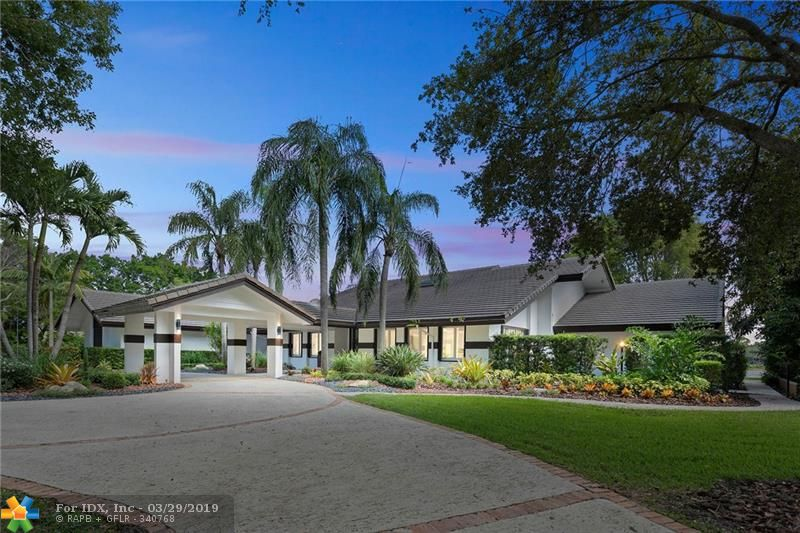 *PRISTINE CONDITION* *SUBSTANTIALLY REMODELED* * BEAUTIFUL PORTE COCHERE ENTRY*  *SOARING VOLUME CEILINGS* *WINDMILL RANCHES ESTATES* BREATHTAKING VIEWS EVERYWHERE ON THIS LARGE 1.86 ACRE LAKEFRONT CUL-DE-SAC LOT, THIS 5/4.5 WITH 7814 TOTAL SQ.FT. A HUGE POOL WITH SPA AND PATIO & GAZEBO AND OUTDOOR SUMMER KITCHEN, CONCRETE DRIVE WITH CHICAGO BRICK, BASKETBALL COURT, ACCORDIAN HURRICANE SHUTTERS, 6 ZONE NEST A/C SYSTEM, ELECTROLUX KITCHEN APPLIANCES, WHIRLPOOL DUET FRONT LOAD WASHER/DRYER, LARGE PANTRY, GORGEOUS NEW HARDWOOD FLOORING, GORGEOUS NEW MASTER BATH WITH HUGE SEPARATE TUB & SHOWER, NEWLY PAINTED, HUGE OFFICE OR THEATER ROOM..