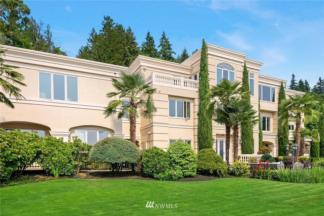 Stately in stature & timeless in design, this classic waterfront residence beckons to be enjoyed for generations to come. Soaring ceilings with generous use of natural stone & crisp custom millwork throughout creates a calming palette, artfully illuminated by natural sunlight. Relish 184' of low bank waterfront with a huge dock, canopy, lift + mesmerizing sunsets. Ring in the day on your lakeside patio amongst arboretum perfect grounds or dine alfresco on one of the many decks. This Grande Dame is dressed to impress: Huge gourmet kitchen, 2 theaters, palatial master suite with fireplace, massive spa inspired bathroom, dreamy dressing room with w/d, billiards room, separate guest house, work out rm etc.! 4 car gar. A dreamy lifestyle awaits!
