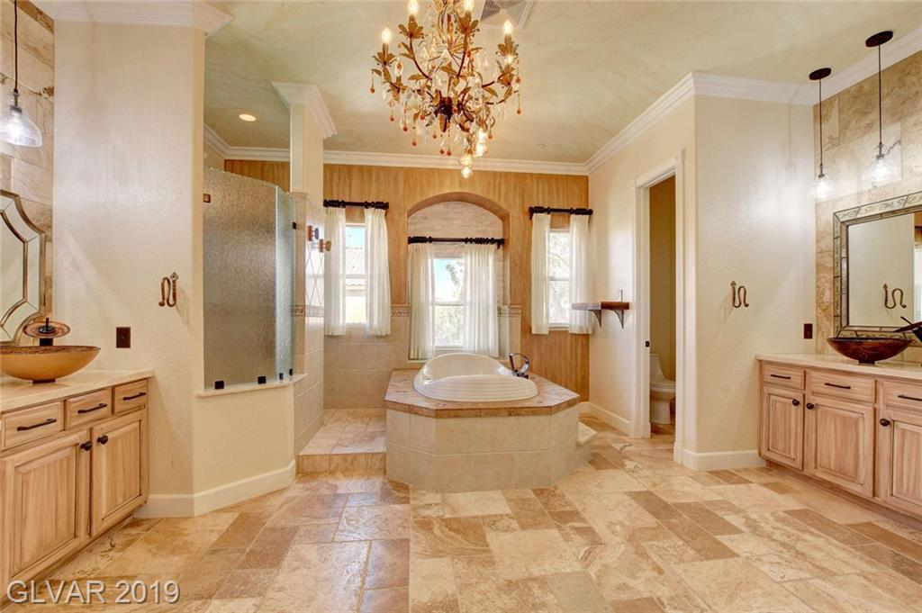 Everywhere you look is customized: from inlaid flooring to painted ceilings to built-ins & rock wall inserts, every door is custom painted, sinks, lights, kitchen built-ins are all custom and stunning! MBR has 2 closets, sitting area, & secret rm, amazing MBA w/chandelier, sep tub, big shower, custom cabs, brand new flooring, carpet only on stairs, newer pool, brand new artificial turf, solar panels, BR down w/murphy bed, custom laundry rm, MORE!