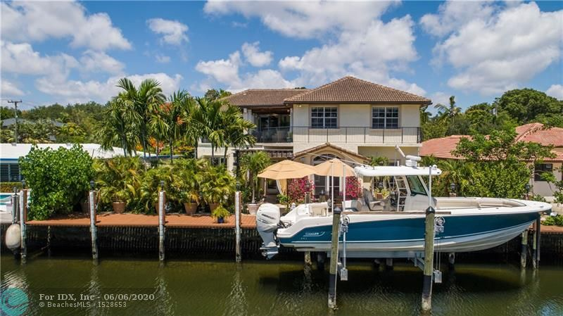 Rebuilt (circa 2006) Tucked Away Location Just East of Victoria Park Rd. 10 Ft Ceilings on Both Levels. 8 Ft Interior Doors. Impact Glass. S-Tile Roof Replaced circa 2006. Newer Seawall to New Code with Trex Dock & 15,000+ Lb. Boat Lift. Heated Salt Water Pool & Marble Paver Pool Deck. Outdoor & Indoor Gas Lanterns. White Marble Floors Throughout. Kitchen has Cherry Cabinetry, Granite Tops, Natural Gas Cooking, Stainless Appliances. 2B/2BA on first Level plus Additional In-Law Suite with Kitchenette. The second Level has Open Living Area with Vaulted Ceiling & Fireplace. Master Suite has Wet Bar, Two Walk-in closets & Access to an Outdoor 20' x 12' Terrace. Master Bath has a Spa Tub, Separate Shower, & Dual Sinks.