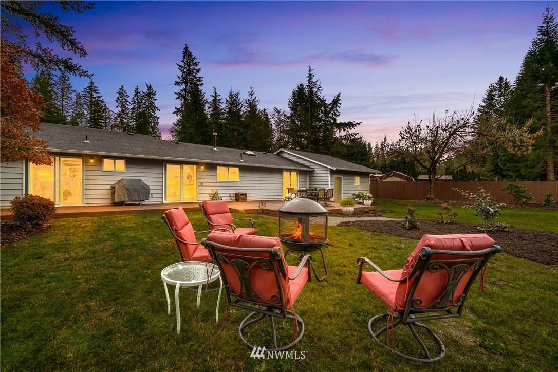 Fall in love with this meticulously maintained & updated 3-bedroom rambler on ½ acre in Sammamish. This home has it all! Fully fenced level backyard with a large deck & storage shed! Fully remodeled kitchen with stainless steel appliances. Newer flooring throughout & freshly painted bedrooms. Cozy open formal living space with fireplace. Added bonus room that is perfect for game nights. Located on a quiet cul-de-sac; Walking distance to Pine Lake, Beaver Lake & Klahanie walking trails. Desirable Issaquah schools. Recently cleaned crawl space. 2 car covered carport features shop with tons of storage space. Don't miss the RV or boat parking on North side of the home!