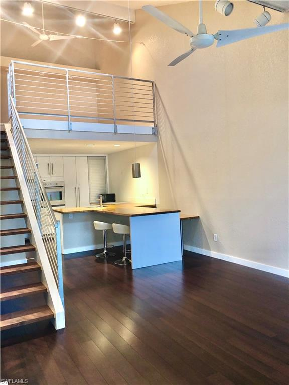 LOCATION!!!  A short walk or bike ride to upscale Mercato shopping & dining complex, beautiful Naples Beaches & Community Parks. This desirable Emerald Woods 1 BDRM+Loft Condo is the perfect vacation or starter home.  At this price it is sure to be one of the best buys in North Naples! Inside, the unit has been tastefully remodeled with hardwood floors in living room, bedroom & kitchen and stylish tiles in the bathroom. A modern white kitchen has ample cabinet space, wooden bar seating, built in-oven and cooktop, stainless steel fridge and washer/dryer in unit. An extra large Master Suite with closet system, two balconies, and gorgeous metal staircase to Den/Loft overlooks the vaulted ceiling living area.  Just a short walk to the tropical landscaped community building with heated pool & spa. This is your perfect chance to own a piece of Naples paradise conveniently located to everything and on NW corner of Pine Ridge Estates.