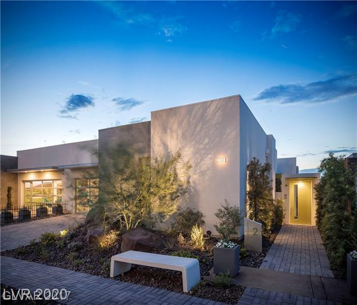 Fully Furnished (excluding artwork and sculptures) Model Home Leaseback/Amazing Investment Opportunity! Must see this stunning Hillside Community by Christopher Homes. This work of art has breathtaking views of the Las Vegas Valley & Strip from Master, Kitchen, Dining Room, Great Room (most rooms). Award winning floor plan with gorgeous interior finishes, state of the art kitchen w/Gaggenau appliances, custom cabinets, 10' high sliding glass doors.  A true Christopher Homes Masterpiece.