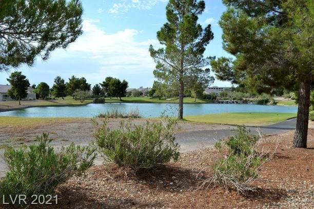 Premium lot has LAKE, fairway and mtn views.  Large bedrooms with an over-sized den that can easily be used as a third bedroom. Beautiful open floor plan, granite counter tops, plenty of cabinet space, large prep island, and separate dining area. Laundry room, 2 car garage, and low HOA dues.  Great club house tennis, exercise facilities and more.