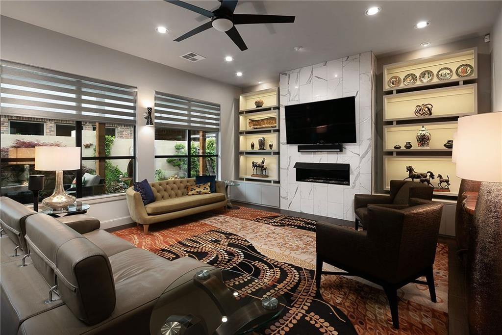 "WOW! Looking for the ""best of the best""? No detail was overlooked in this 3 bed + office custom patio home w/ all the top-of-the-line amenities you crave. Its ultra-modern blend of beauty & utility makes it a standout. Inside, built-in lighted cabinets flank the fireplace with show-stopping elegance. Chef's dream kitchen features lacquered cabinetry with custom pull out shelves, extra storage, huge island w/ pop up elec and USB outlets & under-cabinet lighting, paired with fine appliances to make gourmet cooking a breeze. In the master suite, custom double vanities (one with a lighted, magnified mirror), electrified medicine cabinets, (there's even a urinal!) and high-end fixtures, pamper you to the nines. Custom Alta dual shades, storm cellar, recirculating hot water, H2O descaler, a PureWash laundry sanitizing system, and custom lighting throughout provide added cachet. Outside, a spacious, covered private patio is the perfect space for entertaining. Don't miss this one, call today!"