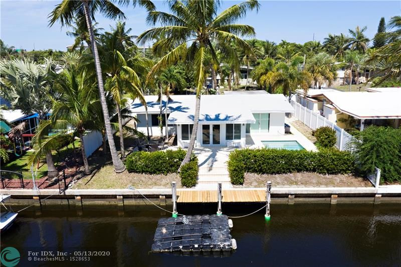 This is truly a Boater's Paradise... located on a wide canal and on a great street in the quiet boating community of Lauderdale Isles. Enjoy your nights entertaining from your poolside patio leading to your own deep water dock with space for a boat with no fixed bridges to the ocean. Wonderful waterfront home located in the sought after neighborhood of Lauderdale Isles. This home is remodeled. Kitchen features stainless steel appliances, new counters, living room with soaring ceilings, impact windows and doors, terrazzo and tile flooring.  Location, Location, Location, minutes from highway, downtown, beaches, Seminole Hard Rock Casino, airport, shopping, dining and so much more. South Florida Living at its best!  Hurry, this won't last!  Don't miss this opportunity!