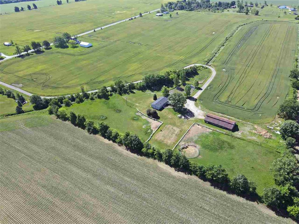 You found your dream home!  Over 55 acres in New Lothrop school district.  Start your farm or horse ranch.  Or till the land and rent out the house.  The possibilities are endless.   Approximately 45 acres are tiled and currently being farmed.  The house offers all the privacy you could ever hope for.  It is completely surrounded by mature trees and sets over 850 feet from the road or closest neighbor.  The only noise you'll hear is the wind blowing across your fields.  The house features 1860 sq ft, 3 beds, 2 baths, spacious kitchen, living room, family room, and a huge unfinished basement that offers lots of storage space.  The horse barn has space for up to 10 stalls.  Book your showing today!