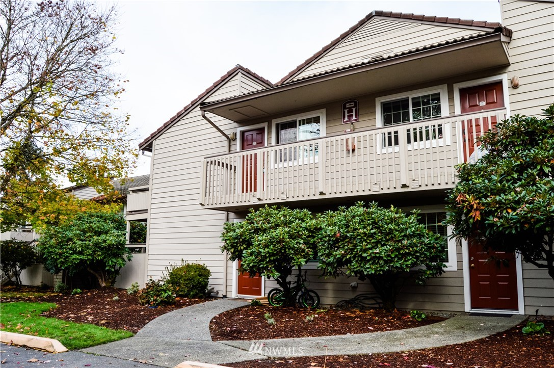 Perfect starter unit or investment opportunity ready for your personal touch! Rare top floor, 2-bedroom 1 bath, corner unit located in Woodland Hills Condominiums in Woodinville. Living Room with Brick Fireplace Features a Balcony Deck with Additional Storage. Tucked away from the main street, but within walking distance to Woodinville Town Center, Restaurants, Burke Gilman Bike Trail, and a short drive to Sensational Wine Country. Quick and easy access to 522 and 405. Private, quiet location with great amenities such as covered parking, a swimming pool, exercise room, cabana, and on-site community amenities and common areas. Solid HOA, no rental cap, no special assessments, and pet-friendly!