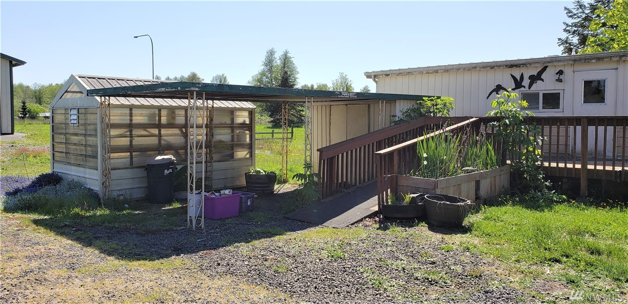 2 bedroom 2 bath manufactured home on 3/4 acre lot that is fully fence lot.  Large shop with oversized rollup insulated doors.  Additional single car garage with extra work area.  Covered car port, green house and pump house for well.  Due to the age of manufactured home (very livable) this is a cash only purchase and is listed as-is.  Highway 12 frontage great location to advertise a home business.