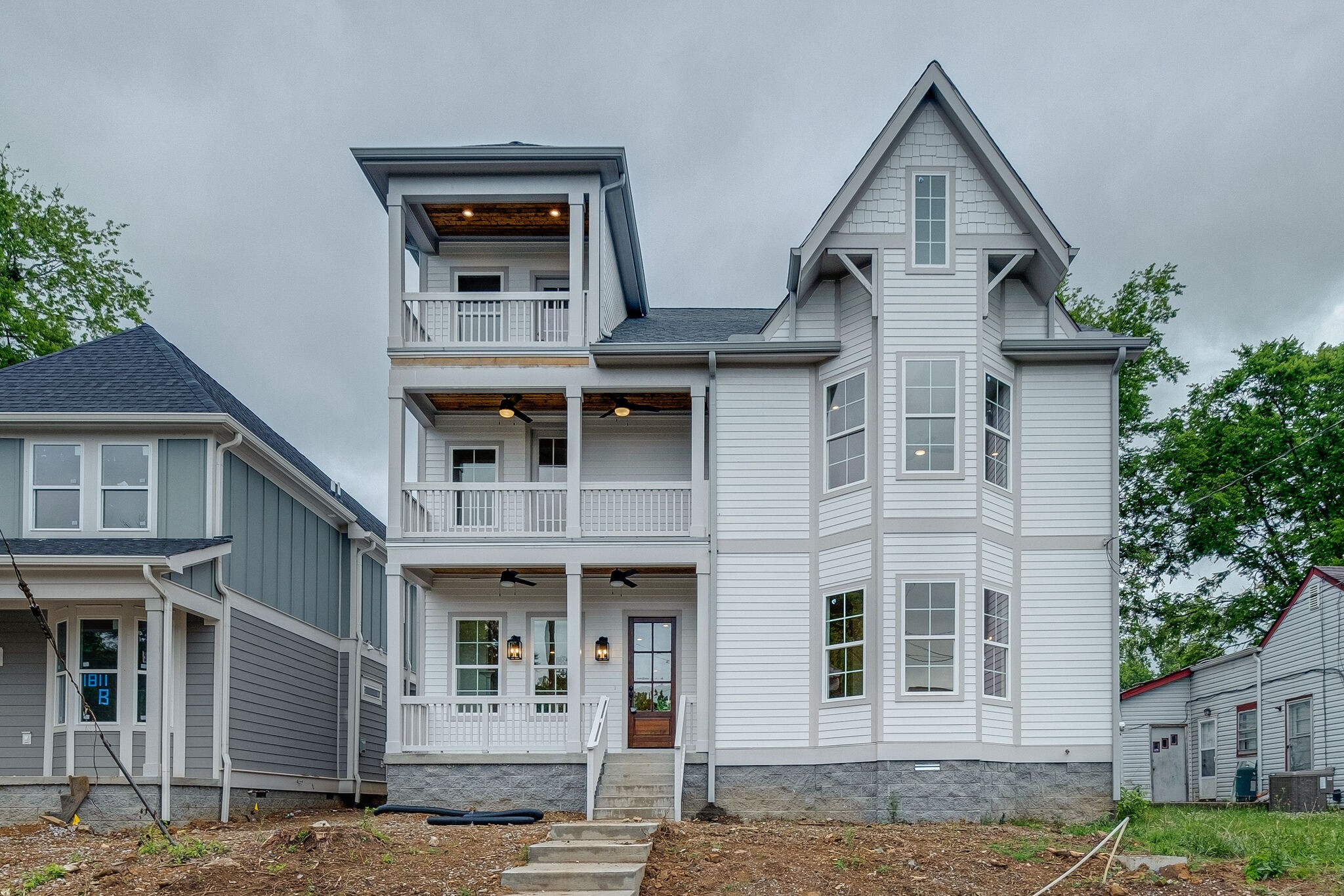 Beautiful, Modern New Construction in the Heart of East Nashville! One Block from the gorgeous views of the Cumberland River! Walk to 5 Points to Eat & Shop! 3 Stories, 5 Bdrms, 4 Decks/Patios! Chef's Kitchen open to living area! Great space for entertaining! Designer Tile, Fixtures, & Finishes!  New 2 car garage w/alley access. Buyer to verify All pertinent info. Agent related to seller.