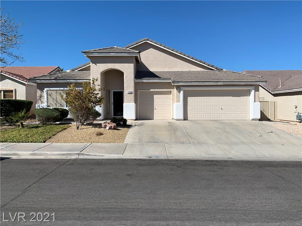 Spacious and attractive one story home with 3 bedrooms plus den. 3 Car garage. Large sized backyard that's desert landscaping and easy to maintain. Open floor plan with separate living room, family room and kitchen. Master bedroom on right with separate shower and tub. Secondary bedrooms on left plus den. Family room comes with high vaulted ceiling and fireplace. Plenty of light in home. Bright house with original owner.
