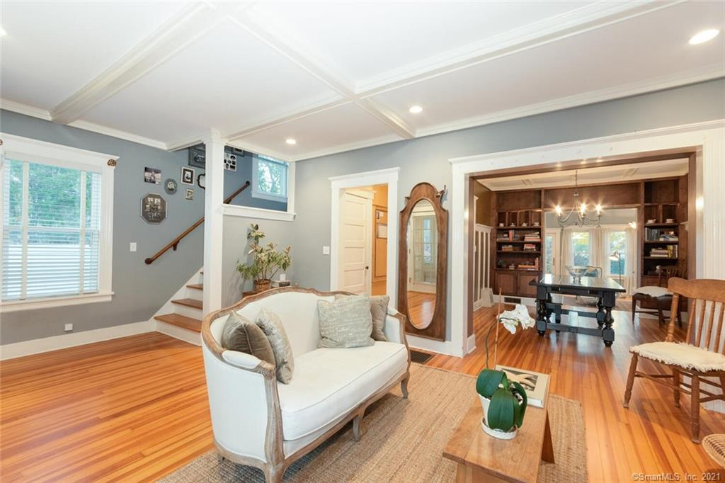 Harkening back to the turn of the century Arts & Crafts Movement, this 1916 built Bungalow/Colonial blends the original detailing & charm w/ modern updates. The 10 year old addition of MBR/MBA & FR is in keeping w/ the original charm & integrity of this home including 9 ft coffered ceilings, gorgeous millwork trim & plenty of built ins. Homes of this era were built w/ the finest materials & possess an abundance of character. A cozy fireplace welcomes you to the front LR, that includes a space for a game table. The DR is central to the 1st floor plan & open to the LR, Kitchen & FR. The EIK cabinetry was handmilled from a single maple tree with cherry trim. Butcher block center island, SS appliances, a pantry closet & built in coat nook complete this Kitchen & overlook the surprise FR addition at the back of the home. You will fall in love with this light filled room that overlooks a stone walled garden through the many windows & French door to the patio. On the 2nd floor you will find 3 BRs, 2 full baths. The front BR has an adorable, built-in, cushioned reading nook and walk in closet. A MBR features a walk in closet plus another double door closet and MBA with tiled tub/shower. A surprise finished room in the lower level has a mirrored wall with bar & half bath. Perfect for a Home Gym,  Bar Method, ballet practice. This home is MUCH LARGER THAN IT APPEARS. All mechanicals, windows, roof are 10 years old. Walk to beach, marina, train, town,shops and more. NOT IN A FLOOD ZONE! Behind the paneled wall in the front part of the LR is a Murphy bed, perfect for aging guests who can't navigate the steps. Also tucked away behind the closed doors of the built ins, on either side of the FP, is a desk that folds down, perfect for at home office or home schooling space.