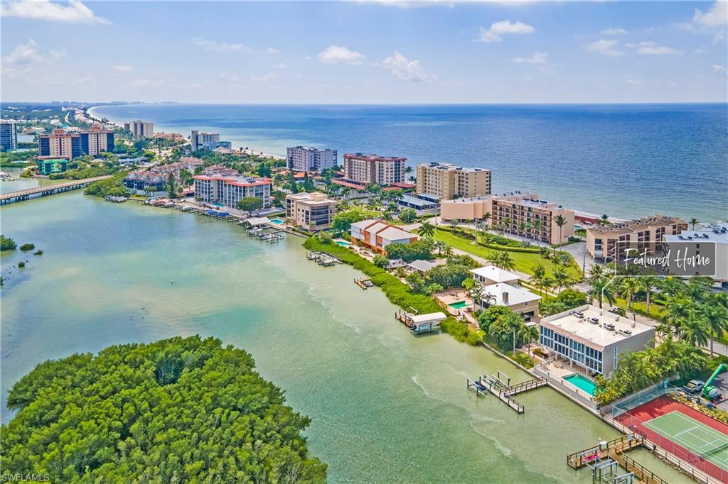 This is the total water experience you have been looking for and we will help you get started. Sea-Doo GTX is included with your purchase. This spacious three-story luxurious waterfront townhouse has been completely remodeled, offers 2079 sq.ft of living area, includes a boat lift for up to 26-foot boats, and spectacular views of the Gulf of Mexico and Bay. Stunning kitchen with new stainless steel appliances, soft-close cabinets, sleek tile backsplash, under-cabinet lighting, and a breakfast bar.  The great room spotlights this end unit's large windows, new stainless steel fixtures, lighted tile accent wall, floor-to-ceiling sliding glass doors, and custom window treatments. Enjoy gulf breezes and sunsets from all of the bedrooms in the home. Two master bedrooms, completely remodeled bathrooms, with new cabinets, custom tile designs throughout, marble countertops, and stainless steel fixtures. The first-floor bonus room is perfect for entertaining and has direct access to the pool. Large carport can fit you small cars. See dolphins swimming in your backyard from your living room or bedroom. Schedule your showing today!