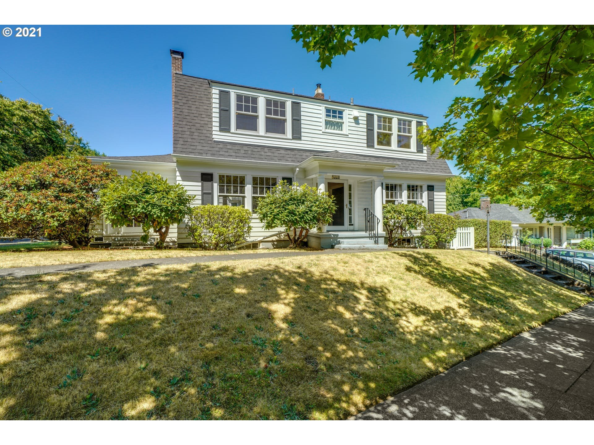 Gracious Laurelhurst Dutch Colonial on quiet corner lot. Grand formal living and dining rooms. Sunroom off living room perfect for den or sitting room. Architectural details include traditional entry hall and staircase, glass doorknobs, picture rail, and more. Lovingly cared for by the same family for over 60 years. Make this wonderful home yours by updating and decorating to your tastes. [Home Energy Score = 2. HES Report at https://rpt.greenbuildingregistry.com/hes/OR10192575]