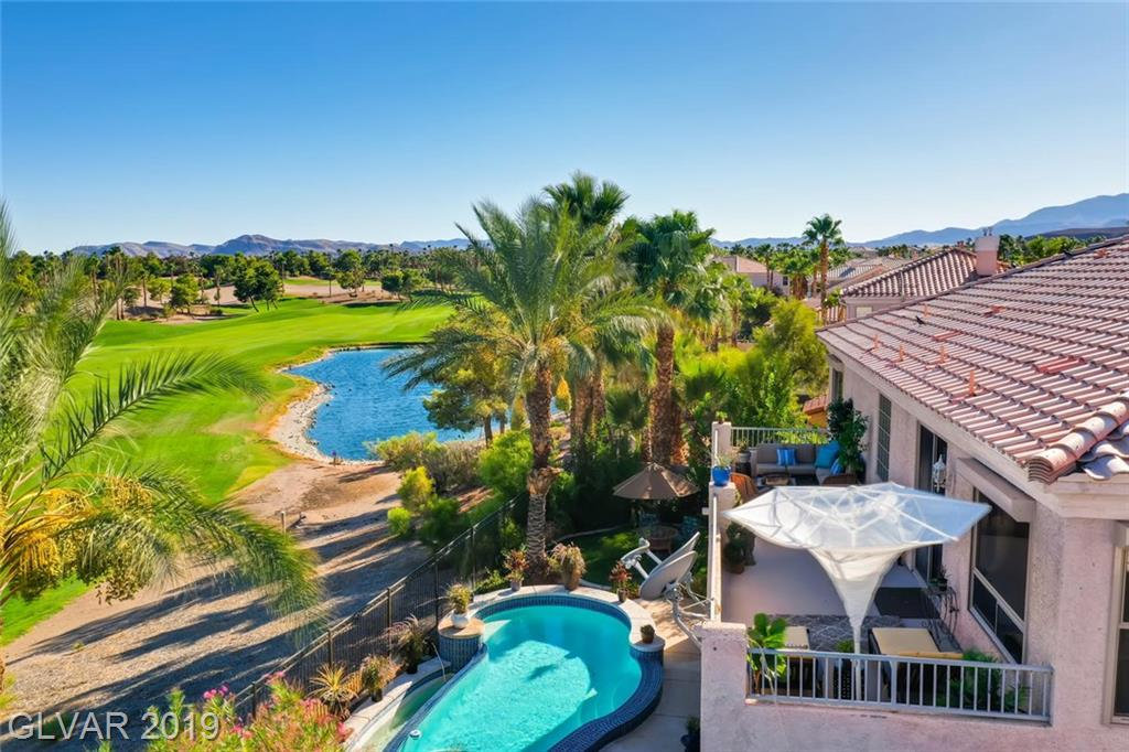 This beautiful Rhodes Ranch home has great views of the 9th Fairway from its backyard oasis, covered patio, and oversized top deck. Home has Rolladen Shutters, has solar power by SOLAR RUN, 2 fireplaces, huge master bedroom with attached exercise room.