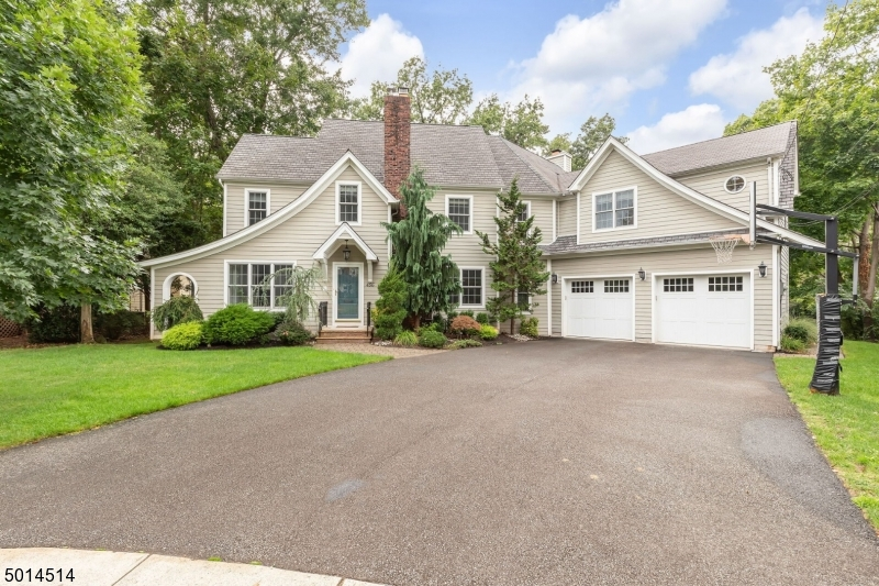This incredibly spacious home was been expanded and renovated and is set on a private 1/2 acre lot! The large EIK overlooks the generously sized family room with gas fireplace and abundant windows. There are 4 comfortably sized bdrms , including a large master w/ walk-in closet + master bath w/ radiant heat, large shower, and separate jetted tub.   The 3rd floor has a leisure room and home office, while the basement offers additional recreational space w/ built-ins and a half bath. Located on a quiet cul-de-sac close to downtown! Amenities include a built-in generator, 2 zone heat & CAC,security system, intercom, distributed audio system in home including back deck/yard area, 2 decks, central vacuum, 2nd flr laundry room. Located on a quiet cul-de-sac close to downtown!