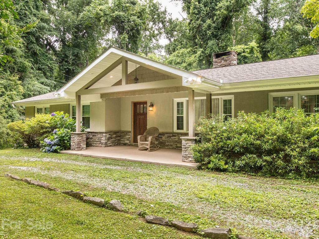 Lovely home updated throughout to todays taste and standards.  This great space is light and bright and in move in condition. Some of our many fine features include:  Updated baths, updated kitchen with gas cooktop, wood floors, fireplace, large deck for entertaining and enjoying the 1.49+- lot.  The sale includes the lot next door which has its own parcel number.  There is plenty of room to roam and enjoy the outdoors.  Conveniently located close to Tryon, Saluda, and Hendersonville.  Come live the good life!